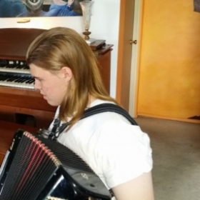 Olsen..first day of accordion lessons!!