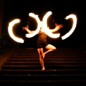 Spinning fire double staffs in tree pose at Alex Grey's CoSM in Wappingers Falls, NY.