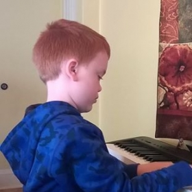 A student during lessons.  It's his birthday, so I let him play a few of his favorite songs.
