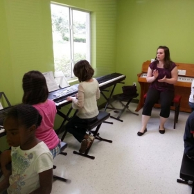 Teaching group piano class at Music N' Art in Riverview, summer of 2013