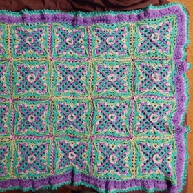 Embellished Granny Square (Crochet) Afghan. Chain, Single, Half Double, Double, Cluster, and Picot Stitches. Plus Twisted Join