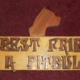 Sign was made with Walnut letters, Redwood dog head and backerboard is Hickory. Took 30-35 hours was priced at $300.00