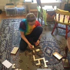 My students enhance their flute study with music theory. My student Linnea playing music theory dominos