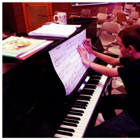 """Helping a student figure out fingering for a version of """"Fur Elise""""."""