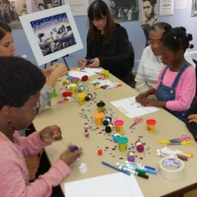 Leading the Benny Andrews interactive workshop at the Schomburg Center in Harlem.