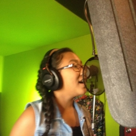Student 12 year old Jazzy Cadient recording a track for her music video