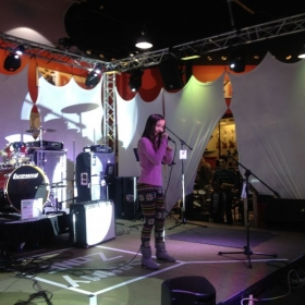 Student 14 year old Ariana Halama singing at Santa Kause benefit toy drive Christmas show