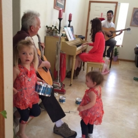 Teaching a family band in their home.
