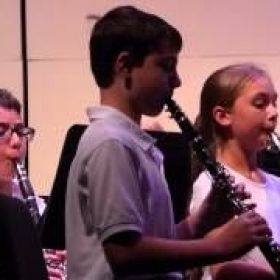 Chris, 4th grader plays the 1st chair clarinet in 5th grade band.