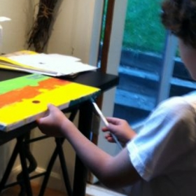 3rd Grader Painting in Acylics