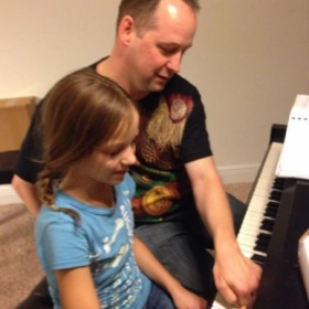 Teaching piano to my neice.