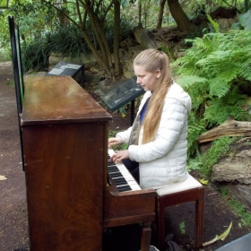 """Trying out one of twelve pianos at the San Francisco Botanical Gardens during their """"Flower Piano"""" event in July 2015."""