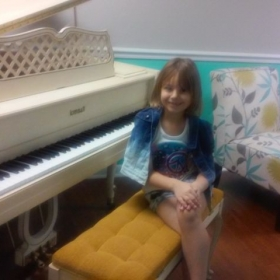 Taking a picture next to the piano for the recital!