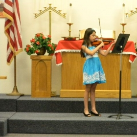 Young violinist at performance