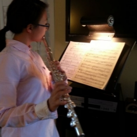Student playing her lesson music
