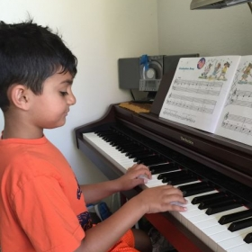 Working on his Graduation song!