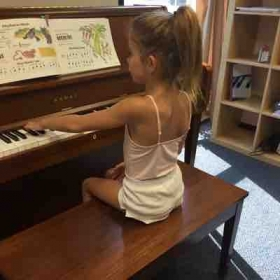 Teaching this little princess . Her second piano lesson