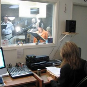 Patricia S. directing voice talent in the booth for a Women In Animation workshop.