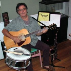 teaching guitar, saxophone, drums, piano, and  more