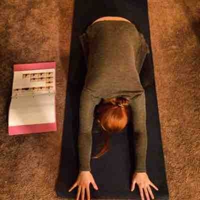 Myself doing child's pose: It opens your back, heart and 3rd eye.
