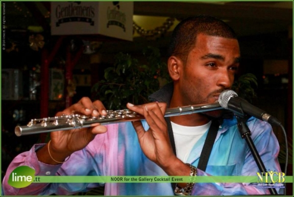 Performing on the flute with the Dominant Seventh Jazz and Calypso Band (2014).
