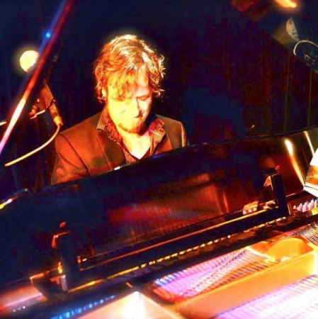 Playing piano during a performance with a long-time vocal student-Santa Barbara, Ca.
