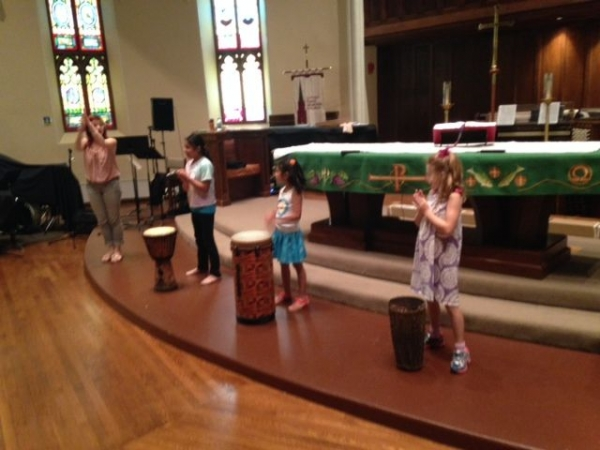 Reinforcing musical concepts with rhythmic and movement activities at church summer camp.