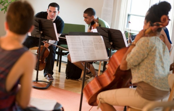 Joshua rehearsing with colleagues at the Institute for Musicianship and Public Service at Community MusicWorks.