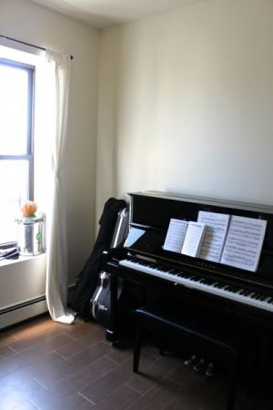 Brooklyn music studio with U1 Yamaha upright, acoustic and electric guitars, and Nord Electro 3 keyboard
