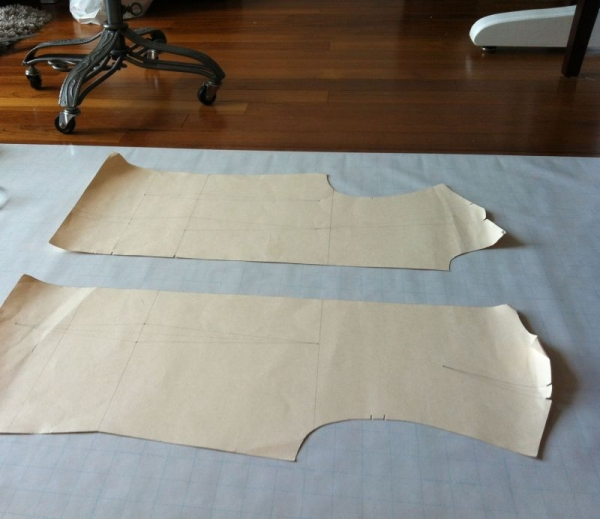 Beginning stages of pattern drafting for a sheath style peterpan collar silk charmeuse and Chantilly lace bridal gown.