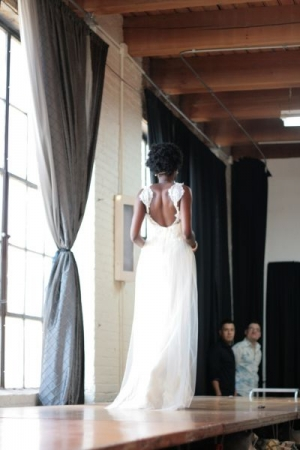 """Back of silk tulle & silk charmeuse, chantilly lace appliqued bridal gown. """"Fabric to Fit"""" bridal fashion show."""