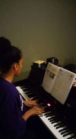Belizian travel Piano Student