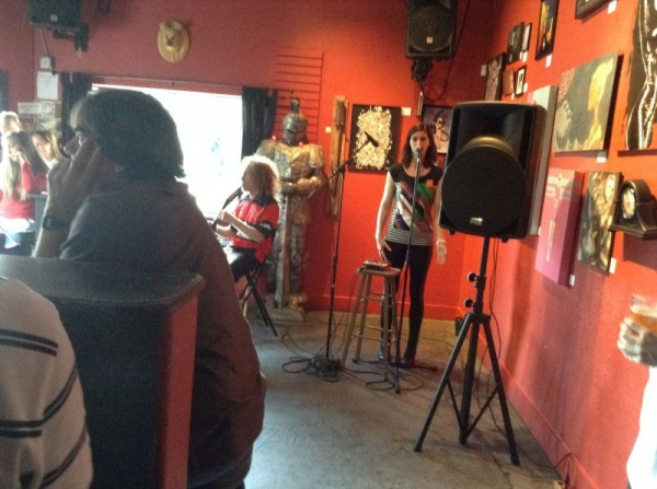 Student Candace Mitchell and her singing partner Gil performing during their CD release party.