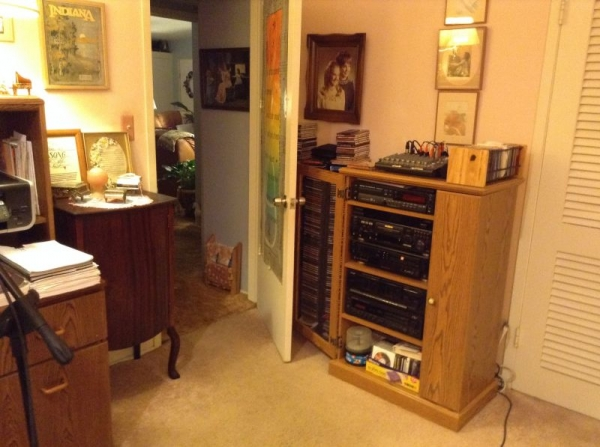 Studio recording equipment and music cabinet.