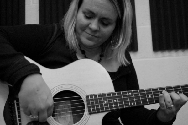 Professional Guitarist Maria Wilson for over 20 years, published guitar composer, instructor and performing artist.