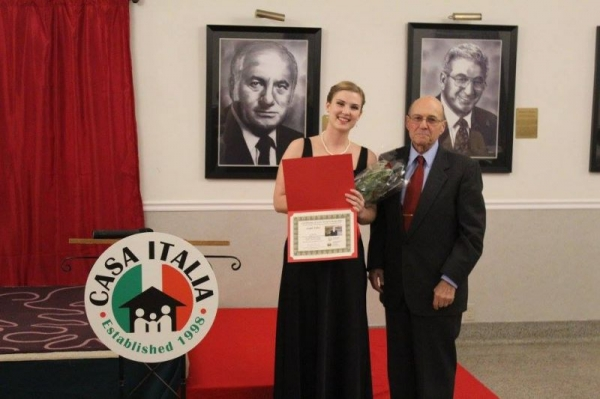 Leigh receiving the First Place prize at the Casa Italia Vocal Competition