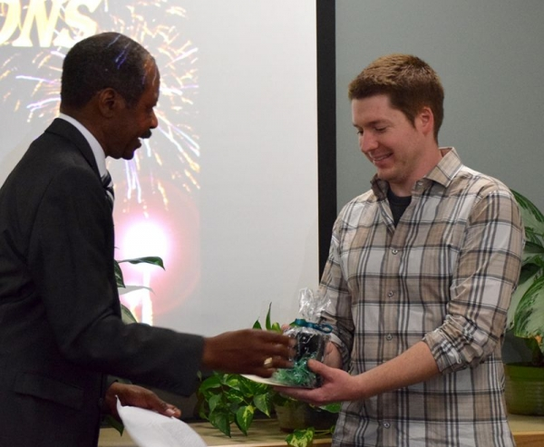 Being presented with a small gift after winning Jack Kent Cooke scholarship.