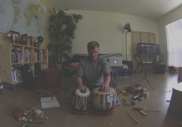 Practicing tabla drums and percussion.