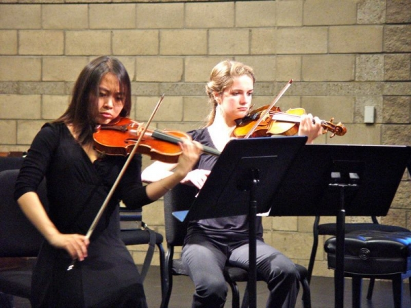 A picture taken during a performance of String Quartet in F Major by Maurice Ravel