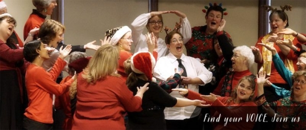 Janet (center, white shirt and tie) performing at one of Women of Note's many holiday performances.