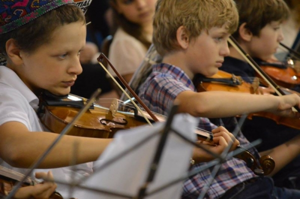 One of my violin students performing in his first orchestra concert.