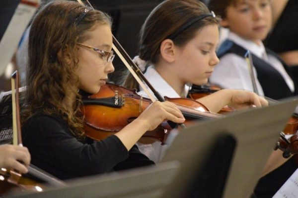 One of my violin students performing in her first Orchestra concert.
