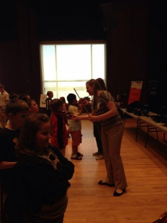 Beginning violin in action! This photo took place at an Instrument Petting Zoo clinic for beginners in the Paducah area public schools.