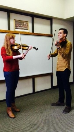 Preparing one of my students for their first violin performance ever!