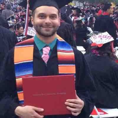 Holding my Bachelor of Music Degree after graduation!
