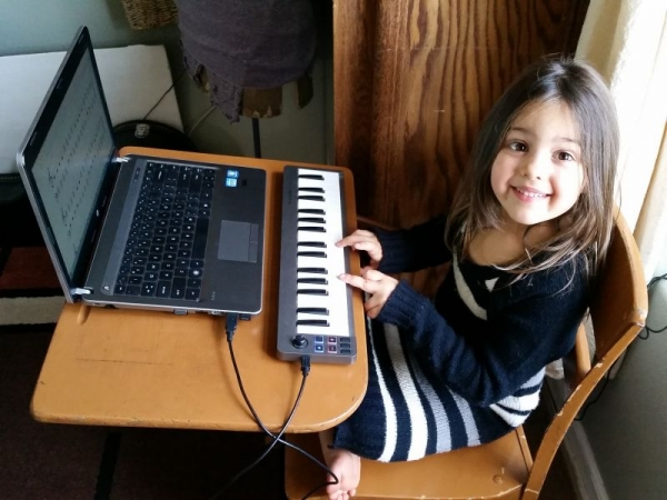 My daughter learning piano via keyboard/computer combo.