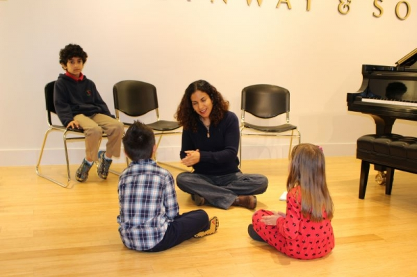 Here I am giving a demonstration at the Steinway Gallery with some of my students
