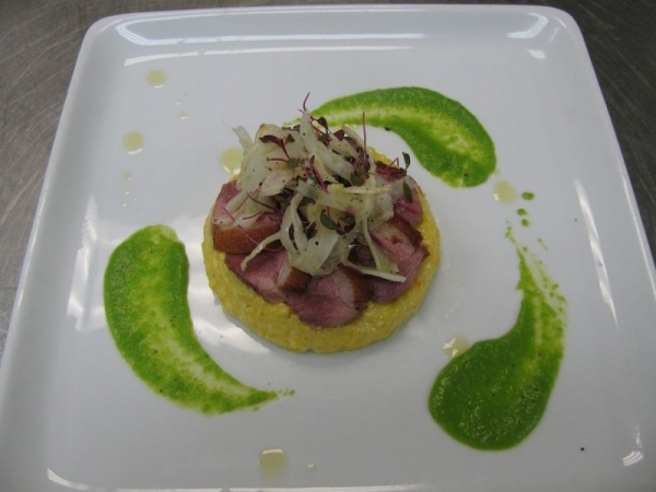 Pan rendered duck breast, saffron risotto, sweet pea puree, fennel salad