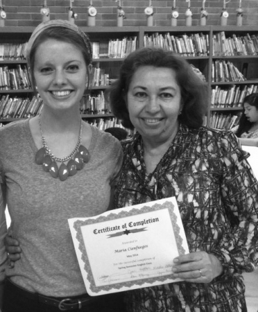 Joy and her ESL student with her certification of completion!