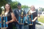 My Student Jocelyn (left) showcasing her trophy after winning second place in a local voice competition.